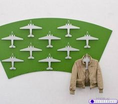 coat rack made from mounted toy airplanes