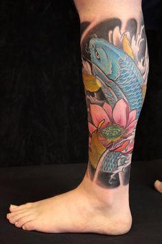 Koi Fish and Lotus Flower Tattoo by Paris Pierides #Tattoo #tattoos #Ink #KoiFish http://tattoopics.org/koi-fish-and-lotus-flower-tattoo-by-paris-pierides/