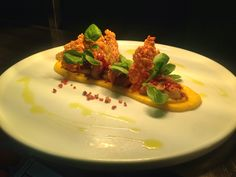 Seared scallops on pumpkin purée with bacon crumble, spinach & Parmesan crisp