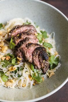 Ginger Beef with Rice Noodles and Herbs from Christopher Kimball's Milk Street For this Vietnamese-inspired beef and rice noodle salad, we liked the rich, meaty flavor of sirloin tips, a cut sometimes sold as flap meat or faux. Beef Soup Recipes, Herb Recipes, Asian Recipes, Cooking Recipes, Noodle Recipes, Noodle Soups, Easy Recipes, Healthy Recipes, Ethnic Recipes