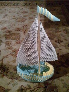 This sailboat is made using modular origami techniques.  Over 500 small parts were made and assembled. The sailboat is approximately 12 inches high.  Watch video at http://youtu.be/88oYCLVvGqQ