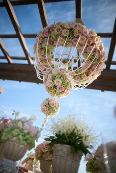Floral Chandelier By Rolling Hills Flower Mart | Wedding flower hanging decoration for a spring summer wedding ceremony