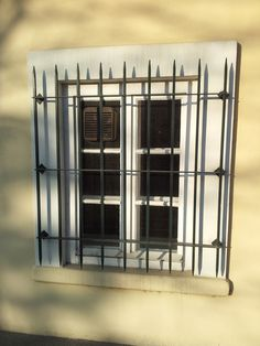 residential window with sharp steel bars