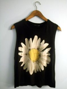make this with bleach and paint for the center of the flower.  Old Tee.
