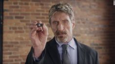 "Fugitive presidential candidate John McAfee is going back to his roots with a new security product that he calls ""a f---ing game changer."""