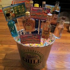 My liquor bouquet :) instead of filling the the bucket with rice or using styrofoam, I used his favorite candy.  Instead of a flower pot, I used a beer bucket that he would definitely use again!