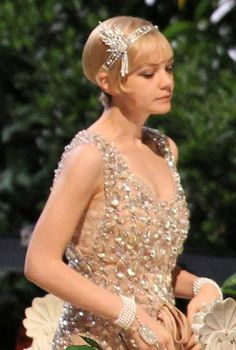 The Italian designer reached back into the the label's archives to outfit Carey Mulligan—Brooks Brothers created suits for Leonard DiCaprio and the other male stars—for Baz Luhrmann's big screen adaptation of The Great Gatsby, due out next summer. Prada also worked with wardrobe designer Catherine Martin to create flapper dresses and other era-appropriate pieces, which were paired with jewels from Tiffany & Co. It?s not the first time the designer has lent her skills to Lurhmann.