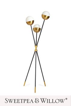 Divinely dynamic, the Caracas Tripod Floor Lamp by Jonathan Adler is light and airy but also has a strong presence and perfect for adding a sense of warmth to your home. The blackened metal stems of differing heights are gathered with a bowtie cuff in antique brass and each stem supports a softly glowing, translucent glass shade. #sweetpeaandwillow #jonathanadler #modernfloorlamp #contemporarylighting Industrial Floor Lamps, Modern Floor Lamps, Sweetpea And Willow, Gold Furniture, Floor Standing Lamps, Gold Home Decor, Translucent Glass, Modern Art Deco, Jonathan Adler