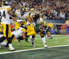 Nick Collins of the Packers scores a touchdown against the Steelers in Super Bowl XLV action at Cowboys (now AT&T) Stadium in Arlington, TX (2011)