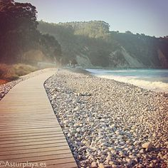 A beach like no other in Asturias: Concha de Artedo in Cudillero, Spain. A wooden platform is installed on the white boulders making this place one of the best beaches in Asturias for... a romantic walk! :))