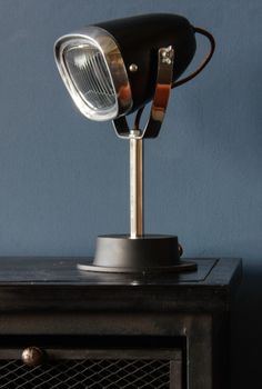 Industrial Vespa Lamp - This quirky but uber cool table lamp would light up any room. Design based upon a Vespa headlamp with a weighted base. Buy now from wheresaintsgo.co.uk/ for £90.00