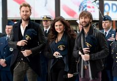 "Charles Kelley, Hillary Scott and Dave Haywood of Lady Antebellum salute the USS New York for a special Veterans Day performance on the ""Today"" show on Nov. 11 in New York"