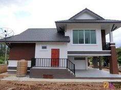 This actual house is elevated in 3 levels, first is the garage floor which is leveled to the natural grade. Second is the porch area level that also includes the living area, dining, kitchen while [. Duplex House Plans, Small House Plans, Small House Design, Modern House Design, Modern Architectural Styles, Double Storey House, Beautiful House Plans, Three Bedroom House, Modern Style Homes