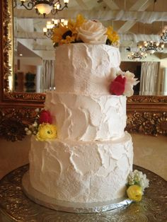 Natural, textured, casual wedding cake with fresh flowers and elegant fondant lace.  Cake by Sugar and Spice Specialty Desserts, Sacramento, CA