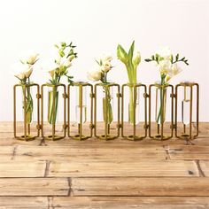 """""""These Our Lavoisier flower vases are inspired by classic laboratory equipment and have a vintage industrial feel - each piece is hinged so that it can be rotated and arranged in various positions. These vases are named for Antoine Lavoisier, the Fre Flower Vase Design, Flower Vases, Flower Arrangements, Vase Centerpieces, Vases Decor, Table Decorations, Small Hinges, Glass Hinges, Wedding Gift Registry"""