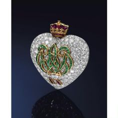 brooche sheart high jewellery diamond emerald ruby crown date pavè round carrès lily