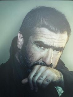 Eric Cantona by Nadav Kander uni brow and hairy knucles, always a sign of a testosterone laden man. Eric Cantona, Premier League Champions, Hard Men, World Press, Photo Awards, Photography Exhibition, Manchester United Football, Handsome Faces, National Portrait Gallery