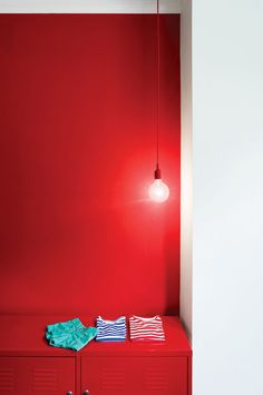 Red locker storage with hanging E27 pendant lamps