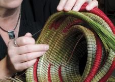 "Muhl grows sweetgrass in pots at home. Last year she grew enough to make one basket - a wedding gift for her son. "" I would love to grow as much as I use,"" she says."