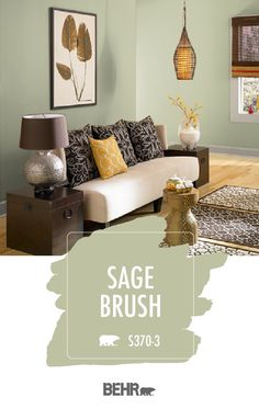 There's nothing like a new coat of paint to refresh the interior design style of your home. That's why we're loving the light green hue of Sage Brush by Behr Paint. Providing a light contrast to the darker shades of brown in this living room, click below to learn more about this fresh summer hue.