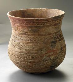 Vaso campaniforme en cerámica roja.
