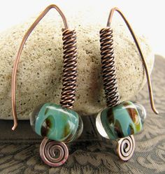 Lampwork & Oxidized Copper Earrings - think this is 3 wires twisted together and then coiled