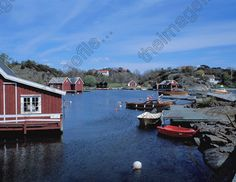 Grimstad Norway | Between Lillesand and Grimstad. Norwegian waterfront timber TIFUK411