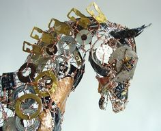 London-based sculptor Barbara Franc creates one-of-a-kind animal sculptures using materials salvaged from discarded objects, such as old food tins, watch parts, and other scrap metal.