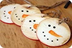 "Snowman gift tags ... backed in red chalk board paint. Made w/3"" discs this would make a cute handmade ornament. I like the chalkboard paint on the back idea."