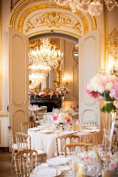 Planned by Fete in France, this elegant Parisian wedding was decorated in a color palette of gold, pinks and purples, with roses and hydrangeas.