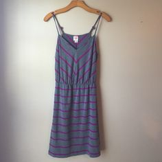 Mossimo Supply Company Gray and Purple Dress Just a fun little comfy dress to wear out or bum around in. It has adjustable spaghetti straps. I have this is two colors because it's so comfy and easy to throw on, but I guess I shall part ways with one of them! Enjoy! Mossimo Supply Co Dresses