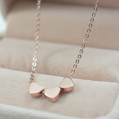 The Three Hearts Rose Gold Necklaces for women would make a lovely gift for any special woman...