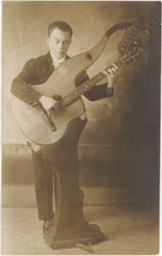 This photograph of Pasquale Taraffo, who came to the US 3 times, is found in the National Archives.   Born in Genoa, Italy, in 1887, the musician began giving guitar concerts at age nine. He eventually switched from the traditional guitar to the harp guitar, a 14-string instrument mounted on a pedestal.