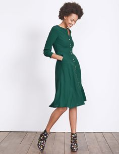 With long sleeves, flattering panels and a sophisticated below-the-knee length, this could be the everyday shirt-dress you've been waiting for. We've added military-inspired epaulettes and gold buttons to really make it pop. The rest is up to you – dress it up or down and watch your friends salute your style.