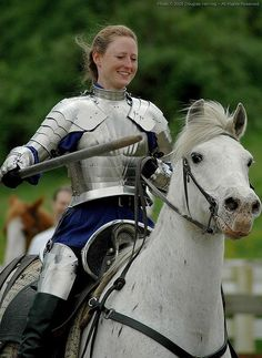 Laughing she wheeled her horse around holding her sword aloft triumphantly.