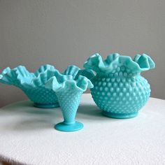 Turquoise Blue Hobnail Milk Glass Vase by Fenton!  Hobnail glassware gets its name from the studs, or round projections, on the surface of the glass. These studs were thought to resemble the impressions made by hobnails, a type of large-headed nail used in bootmaking.  Fenton Art Glass introduced Hobnail Glass in translucent colors in 1939 & Milk Glass Hobnail in 1950