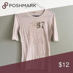 "Aeropostale graphic tee Aeropostale graphic print tee with ""87"" royal crest watermark. Oatmeal color, half sleeve length. Looks great under jackets. Aeropostale Tops Tees - Long Sleeve"