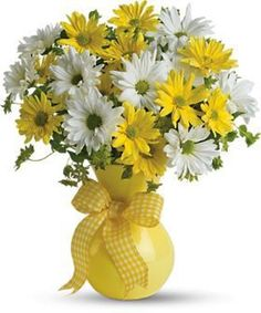 What could be sweeter than a cheerful yellow vase filled with white and yellow daisies? Then choose this sunny bouquet. It will brighten their day. The bright bouquet includes white daisy spray chrysanthemums, yellow daisy spra Purple Tulips, Yellow Daisies, Yellow Vase, Bright Yellow, Easter Flowers, Summer Flowers, Daisy Flowers, Daisies Bouquet, Cheap Flowers