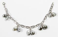 Lot 125: 18k White Gold and Pearl Bracelet; Chain bracelet having gray pearl charms; marked 750 on clasp
