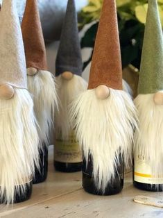 These winters gnomes are actually wine bottle toppers! The hats are hollow, so they fit perfectly on any bottle. Don't drink wine? Wine Bottle Covers, Wine Bottle Art, Painted Wine Bottles, Liquor Bottles, Soda Bottles, Glass Bottles, Cork Crafts, Christmas Projects, Holiday Crafts