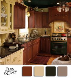 A traditional kitchen using natural brown stain and white creme cabinets with a some taupe accents