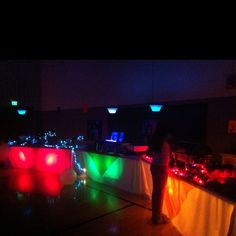 "My daughters Sweet 16 lighting under the buffet tables for her ""Blackout Neon Theme"" party"