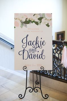 Oklahoma spring time wedding. The wedding colors were peach, pink, blush and navy. We had an outdoor ceremony and indoor reception. This wedding welcome sign design has pink and peach garden roses with draped eucalyptus in a bohemian garden style.