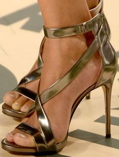"""Halle paired her Versace with the Vince Camuto """"Devin"""" sandals in metallic leather"""