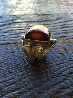 This is a unique Amber #ring with bone and topaz accents , very bold as well