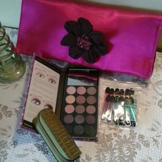 "NWOT from Ulta. Gorgeous gift pack! Includes a small but super-pretty 10"" x 5"" evening clutch with brown satiny interior. No pockets, but snaps shut. Big enough for a cell phone, lipstick and small wallet. Retail value $28.  Comes with a small croc lipstick case, value $4. Set of 12 eyeshadow applicators also valued at $4.  PLUS a brand new set of 15 eyeshadow colors in a glitter box with a mirror. Value $15 at Ulta.   What a treat! Profusion Bags Clutches & Wristlets"