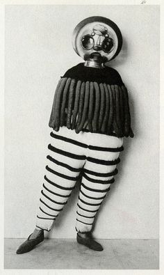 "Lance finally had to admit he was a slave to fashion.    Costume for the Triadic Ballet from ""The Theater of the Bauhaus"""