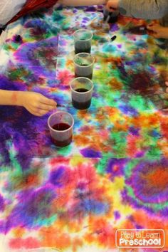 Play to Learn Preschool - Large Scale Paper Towel printing in the classroom
