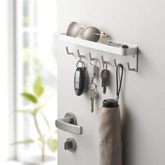 This Key Rack by Yamazaki is magnetic and will stick to the back of any metal front door. It contains many hooks for keys, and has a shelf on top to hold other items, for storage, or decoration. Magnetic Key Holder, Narrow Shelves, Door Organizer, Entryway Organization, Key Rack, Key Hooks, Easy Home Decor, Organizing Your Home, Woodworking