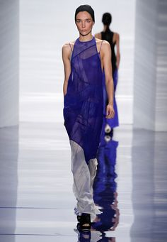 Look 17:  Cobalt silk chiffon halter neck gown with circular seams, bi-color hem and mesh inlays . Cobalt silk chiffon camisole slip with hand painted brush strokes.